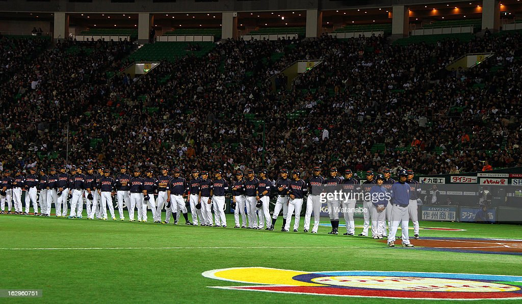 Japan team line up for national anthem with teammate during the World Baseball Classic First Round Group A game between Brazil and Japan at Fukuoka Yahoo! Japan Dome on March 2, 2013 in Fukuoka, Japan.