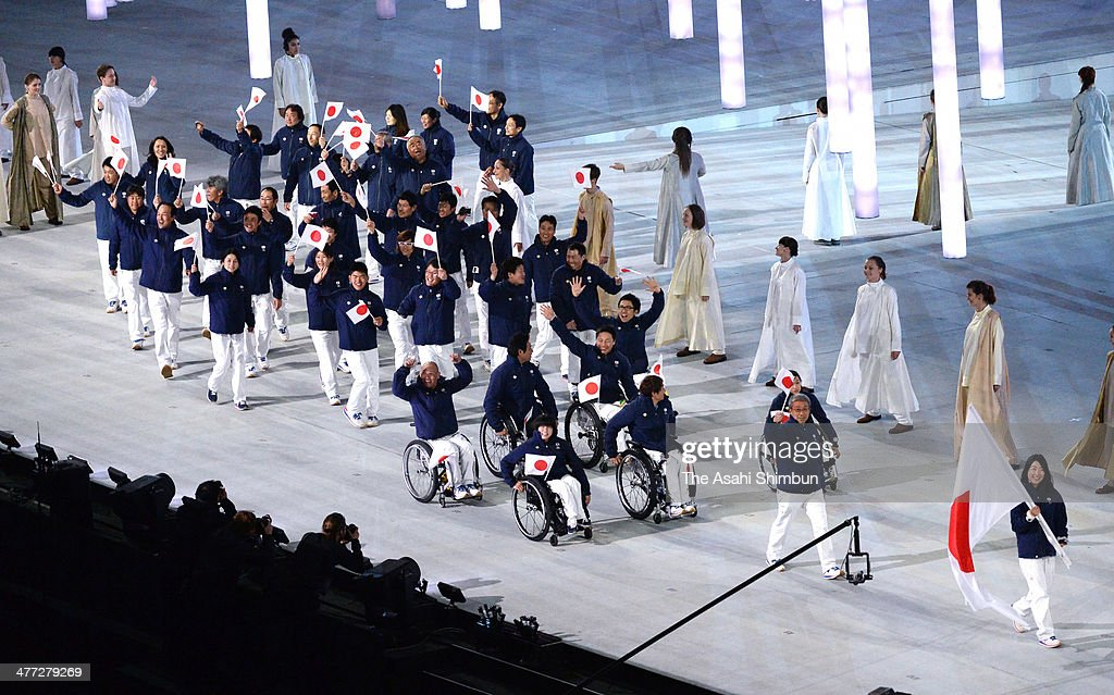Japan team members enter led by flag bearer Shoko Ota (1st R) during the Opening Ceremony of the Sochi 2014 Paralympic Winter Games at Fisht Stadium on March 7, 2014 in Sochi, Russia.