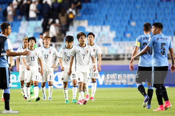 Japan team players show dejection after their 02 defea during the FIFA U20 World Cup Korea Republic 2017 group D match between Uruguay and Japan at...