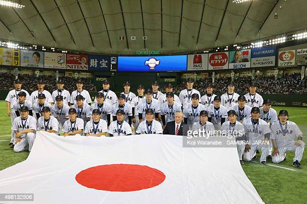 Japan team pose for a team photo after winning the WBSC Premier 12 third place play off match between Japan and Mexico at the Tokyo Dome on November...