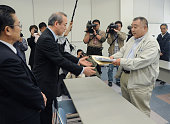 IWAKI Japan Tetsu Nozaki head of a local fishing cooperative in Fukushima Prefecture hands a letter of compensation demand to an official of Tokyo...