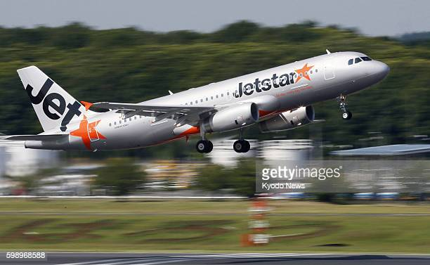 NARITA Japan The first flight of Jetstar Japan Co a budget airline funded by Japan Airlines Co leaves the carrier's base at Narita airport near Tokyo...