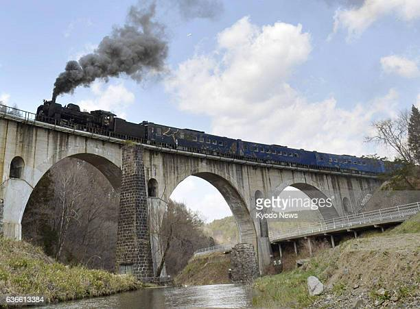 TONO Japan The steam locomotiveled 'SL Ginga' crosses a bridge on JR Kamaishi Line in Tono Iwate Prefecture northeastern Japan on April 12 as East...