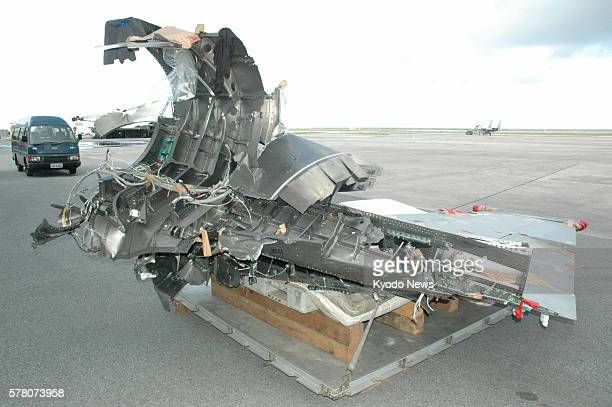 NAHA Japan The vertical tail fin of an F15 fighter retrieved from the East China Sea is shown to reporters at an Air SelfDefense Force base in Naha...