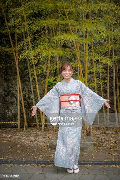 Japan, Tokyo, Asian woman in Japanese Kimono on the bamboo background