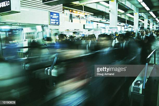 Japan, Tokyo, commuters in Shinjuku underground station (Digital Enhan