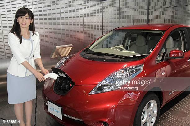 Japan Tokyo Ginza Chuo Hamuri Dori Street kanji hiragana katakana characters symbols Nissan Leaf electric vehicle car models zero emissions