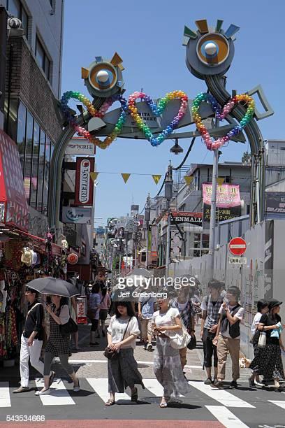 Japan Tokyo Harajuku Takeshita Dori Street shopping shoppers Asian woman teen girl boy entrance arch balloons