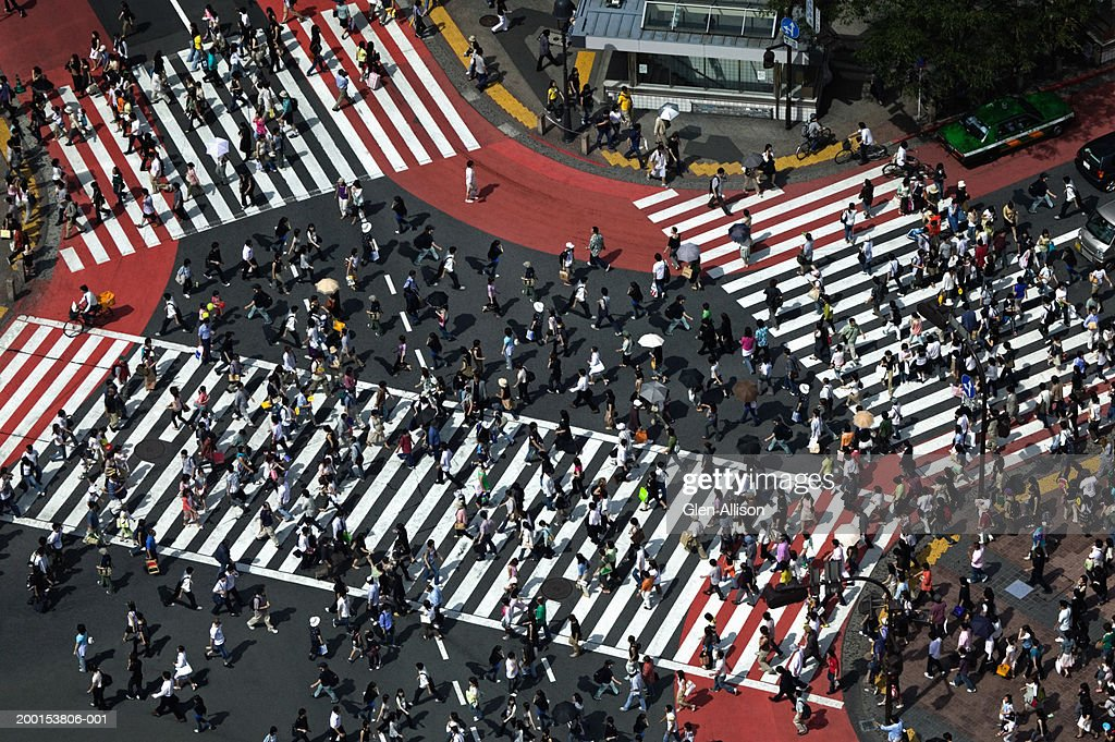 Japan, Tokyo, Shibuya, pedestrians crossing street, elevated view : Stock Photo