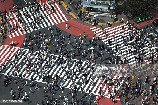 Japan, Tokyo, Shibuya, pedestrians crossing street, elevated view