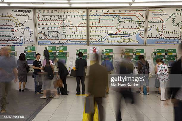 Japan, Tokyo, Shibuya subway station, commuters (blurred motion)