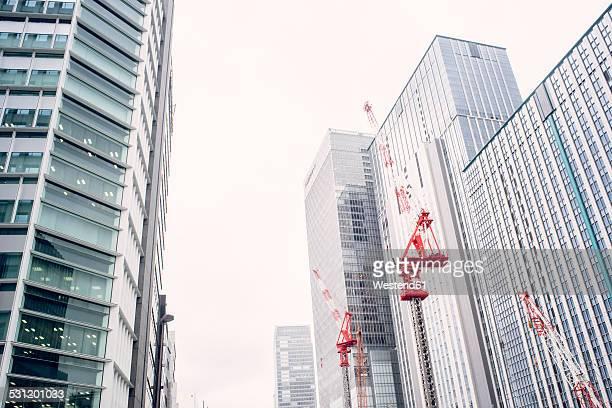 Japan, Tokyo, Skypscrapers and construction cranes