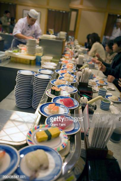 Japan, Tokyo, sushi restaurant with moving display