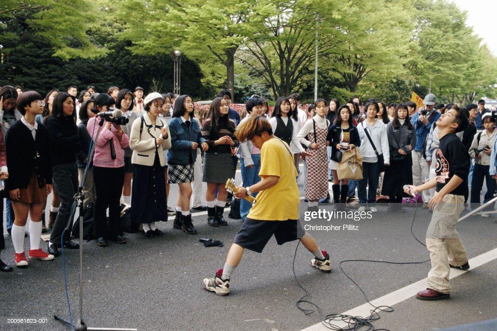Japan, Tokyo, teenage boys (16-17) in rock band playing at Yoyogi Park : Stock Photo
