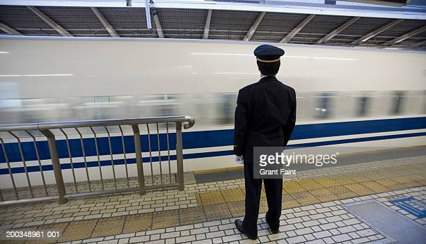 Japan, Tokyo, train conductor, rear view (blurred motion)