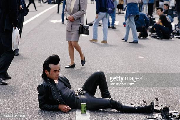 Japan, Tokyo, Yoyogi Park, teddy boy lying on street