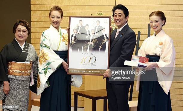 TOKYO Japan Top stars of the Takarazuka Revue Reon Yuzuki and Nene Yumesaki pay a courtesy call on Prime Minister Shinzo Abe at his office in Tokyo...