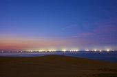 Japan, tottori sand dunes fishing fire in sea