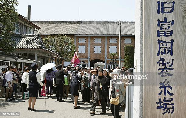 TOMIKOKA Japan Tourists flock to the Tomioka Silk Mill a historic building in Tomioka Gunma Prefecture on April 2014 the day after the facility was...