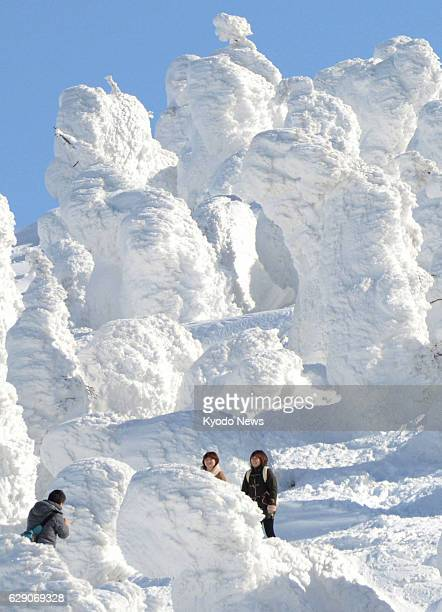 YAMAGATA Japan Tourists take photos of themselves with 'Ice Monsters' or snowcoated trees at the Zao hot spring and skiing resort in Yamagata...