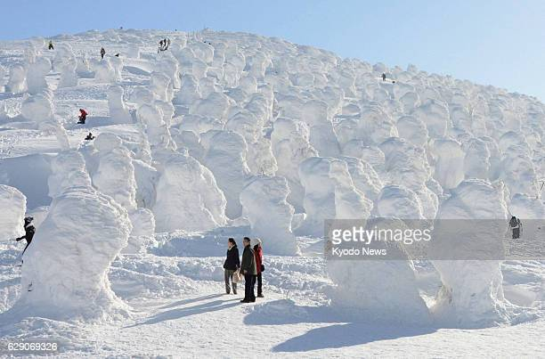 YAMAGATA Japan Tourists walk among 'Ice Monsters' or snowcoated trees at the Zao hot spring and skiing resort in Yamagata Prefecture northeastern...