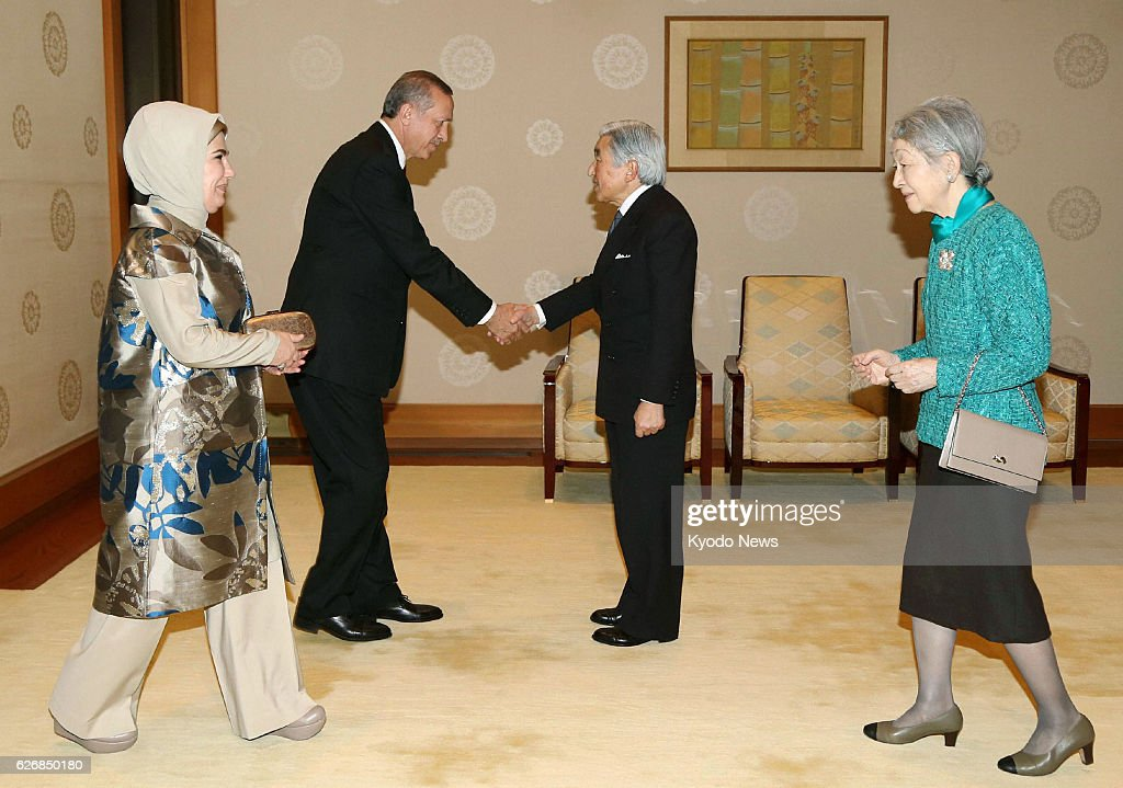 TOKYO, Japan - Turkish Prime Minister Recep Tayyip Erdogan (2nd from L) and his wife Emine (L) are greeted by Japanese Emperor Akihito (2nd from R) and Empress Michiko at the Imperial Palace in Tokyo on Jan. 8, 2014, the last day of a three-day visit to Japan by the Turkish prime minister.