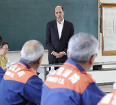 OFUNATO Japan US Ambassador to Japan John Roos listens to Japanese firefighters who cooperated with a US relief team at a firefighting station in...