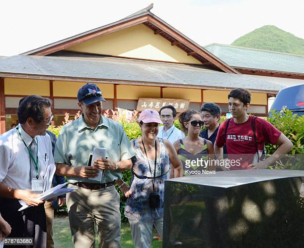 YAMAGATA Japan US Ambassador to Japan John Roos looks at the writing on a monument contributed by former US Ambassador to Japan Edwin Reischauer at...