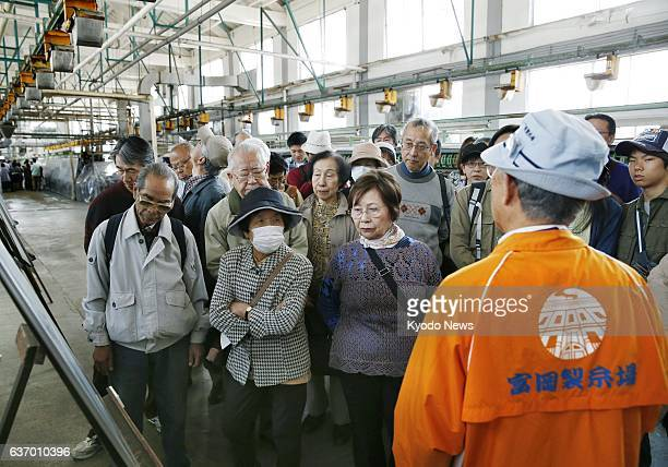 TOMIOKA Japan Visitors listen to explanations by a volunteer guide inside the Tomioka Silk Mill in the city of Tomioka Gunma Prefecture on April 26...