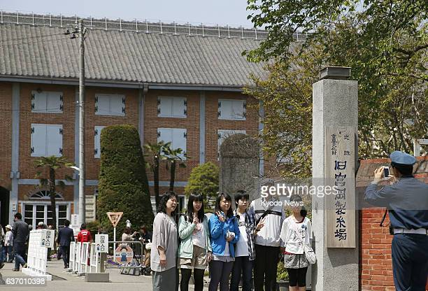 TOMIOKA Japan Visitors take a photo at the main gate of the Tomioka Silk Mill in the city of Tomioka Gunma Prefecture on April 26 after a UNESCO...