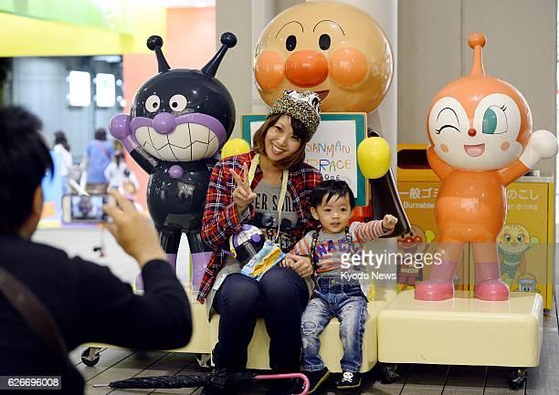 KOBE Japan Visitors take souvenir photos at the Anpanman museum in Kobe on Oct 15 2013 Takashi Yanase the creator of Anpanman a character from one of...