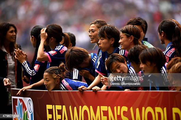 Japan waits after given their second place medals after their 52 to the United States in the FIFA Women's World Cup Canada 2015 Final at BC Place...