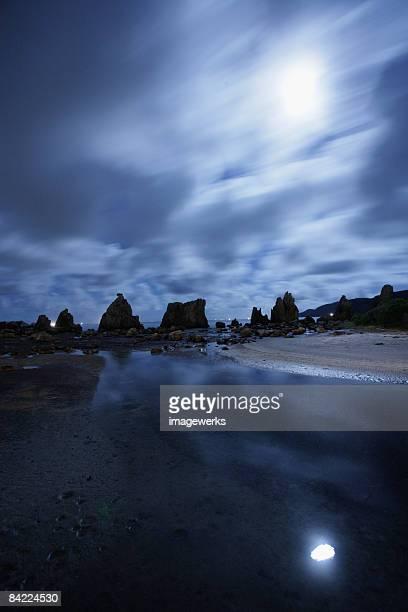 Japan, Wakayama Prefecture, Hashigui-Iwa rocks at night