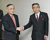 TOKYO Japan Wi Sung Lac South Korea's chief envoy to the sixparty talks on denuclearizing North Korea shakes hands with his Japanese counterpart...