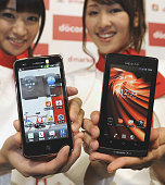 TOKYO Japan Women hold NTT Docomo Inc's Androidbased smartphone models capable of using the company's highspeed data communication service called Xi...