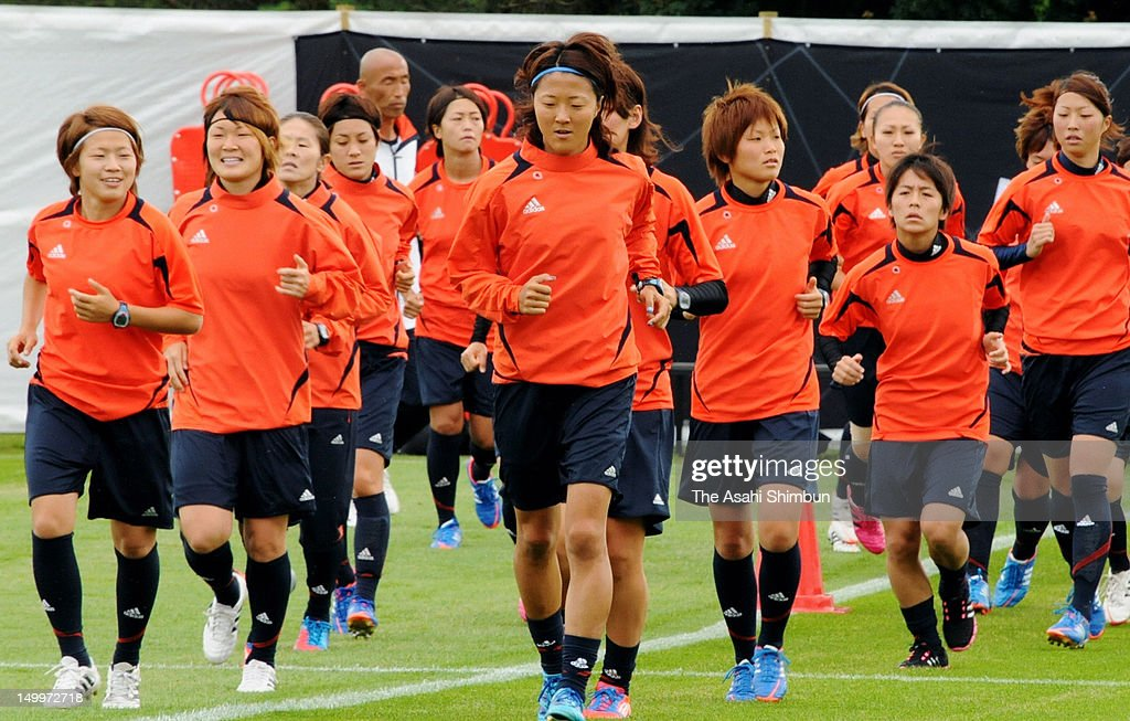 Japan Women's football team members warm up during their first training ahead of the London Olympic in Great Britain on July 21, 2012 in Coventry, England.