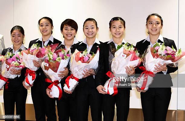 Japan Women's Gymnastics team members Asuka Teramoto Natsumi Sasada Mai Murakami Sae Miyakawa Aiko Sugihara and Sakura Yumoto pose for photographs...