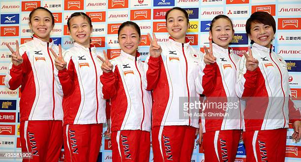 Japan Women's Gymnastics team members Sakura Yumoto Aiko Sugihara Asuka Teramoto Natsumi Sasada Sae Miyakawa and Mai Murakami pose for photographs...