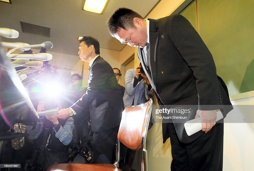 Japan Women's Judo national team head coach Ryuji Sonoda bows for apology during a press conference on January 31, 2013 in Tokyo, Japan. Sonoda announced he will resign as head coach of the Japanese women's judo team following revelations he used violence and harassed judoka under him.
