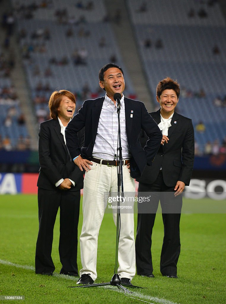 Japan Women's national team head coach Norio Sasaki speaks while Aya Miyama and Miho Fukumoto smile prior to the FIFA U-20 Women's World Cup Group A match between Japan and Mexico at Miyagi Stadium on August 19, 2012 in Rifu, Miyagi, Japan.