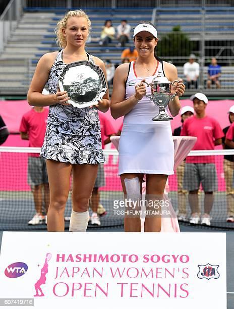 Japan Women's Open tennis singles winner Christina McHale of the US poses while holding her trophy beside runnerup Katerina Siniakova of Czech...
