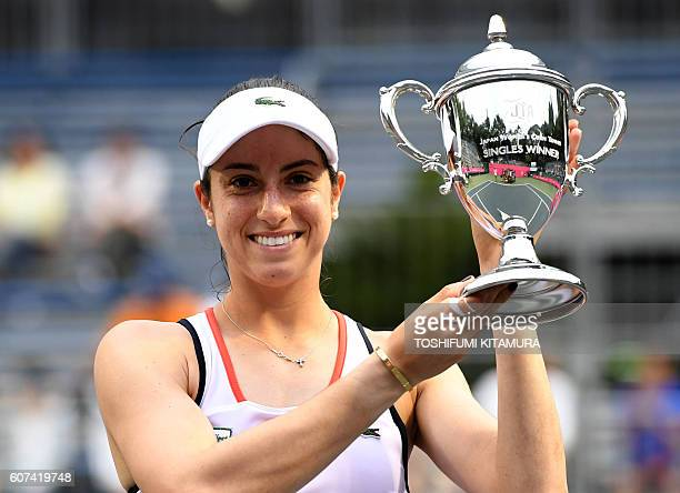 Japan Women's Open tennis singles winner Christina McHale of the US poses while holding her trophy during the awarding ceremony in Tokyo on September...