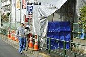 TOKYO Japan Workers measure radiation levels at a blocked road beside the premises of a supermarket in Tokyo's Setagaya Ward on Nov 15 before an...
