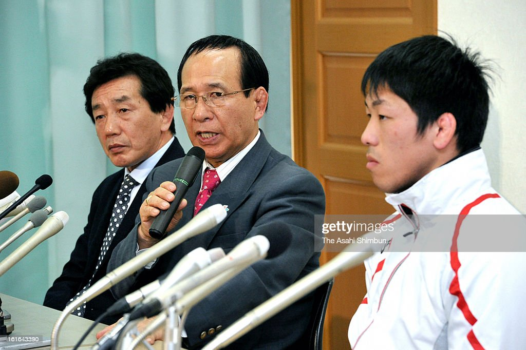 Japan Wrestling Federation President Tomiaki Fukuda (C)speaks while gold medalist <a gi-track='captionPersonalityLinkClicked' href=/galleries/search?phrase=Tatsuhiro+Yonemitsu&family=editorial&specificpeople=7359200 ng-click='$event.stopPropagation()'>Tatsuhiro Yonemitsu</a> listens during a press conference at Kishi Memorial Gymnasium on February 13, 2013 in Tokyo, Japan. International Olympic Committee's decision to drop wrestling from 2020 Summer Olympic stuns Japan, as Japan won six medals in Wrestling including four gold at London Olympic.