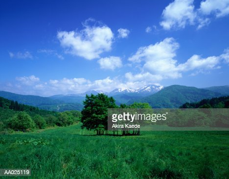 Japan, Yamagata Prefecture, green hills and Mount Gassan in background