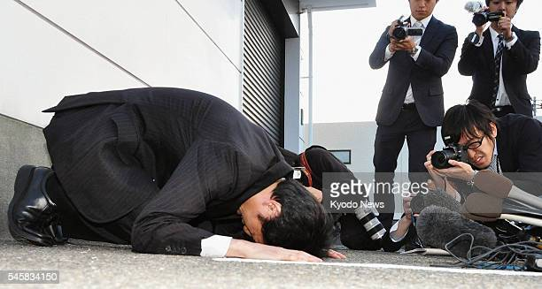 KANAZAWA Japan Yasuhiro Kanzaka president of Foods Forus Co prostrates himself in apology in front of the company's head office in Kanazawa Ishikawa...