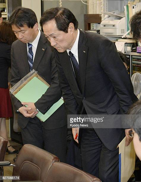 TOKYO Japan Yasuhiro Sato president of Mizuho Bank bows after a press conference in Tokyo on Jan 23 on his resignation following the megabank's...