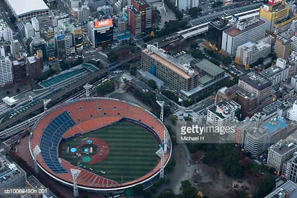 Japan, Yokohama, Kanagawa, Cityscape and Yokohama stadium, aerial view