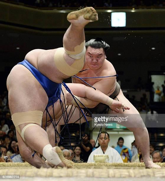 TOKYO Japan Yokozuna Hakuho beats ozeki Kotoshogiku at Ryogoku Kokugikan in Tokyo on Sept 26 the 12th day of the Autumn Grand Sumo Tournament Hakuho...