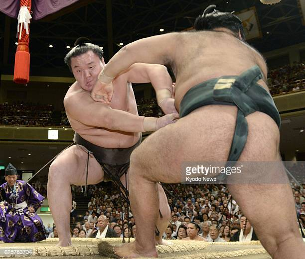 TOKYO Japan Yokozuna Hakuho forces komusubi Takayasu out of the ring on Sept 15 the opening day of the Autumn Grand Sumo Tournament at Ryogoku...